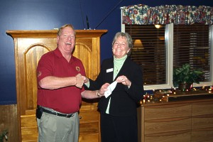 Tom Budzynski Presents $10,000 to Alexandra House