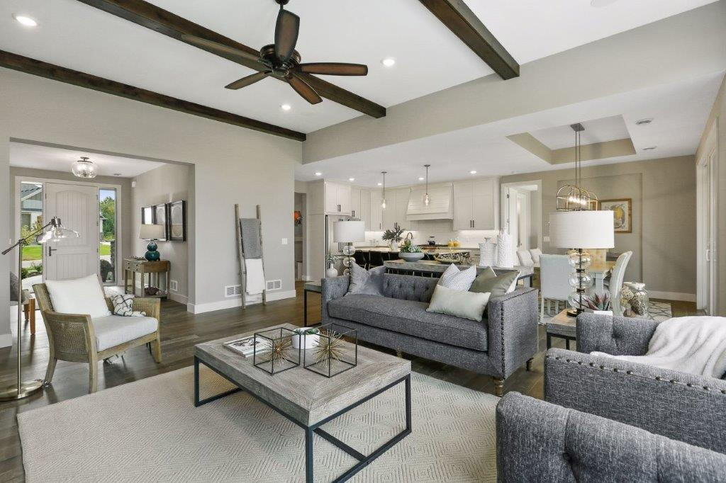 Stunning family room featuring beamed ceiling details