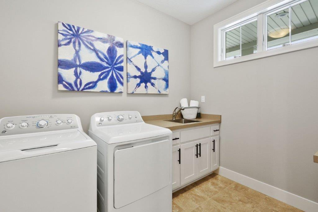 Spacious laundry and mudroom with a walk-in closet