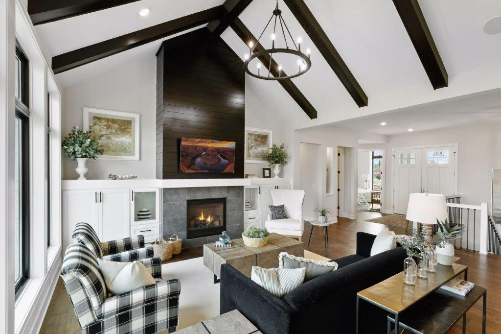 Custom-designed fireplace all with flanking built-ins