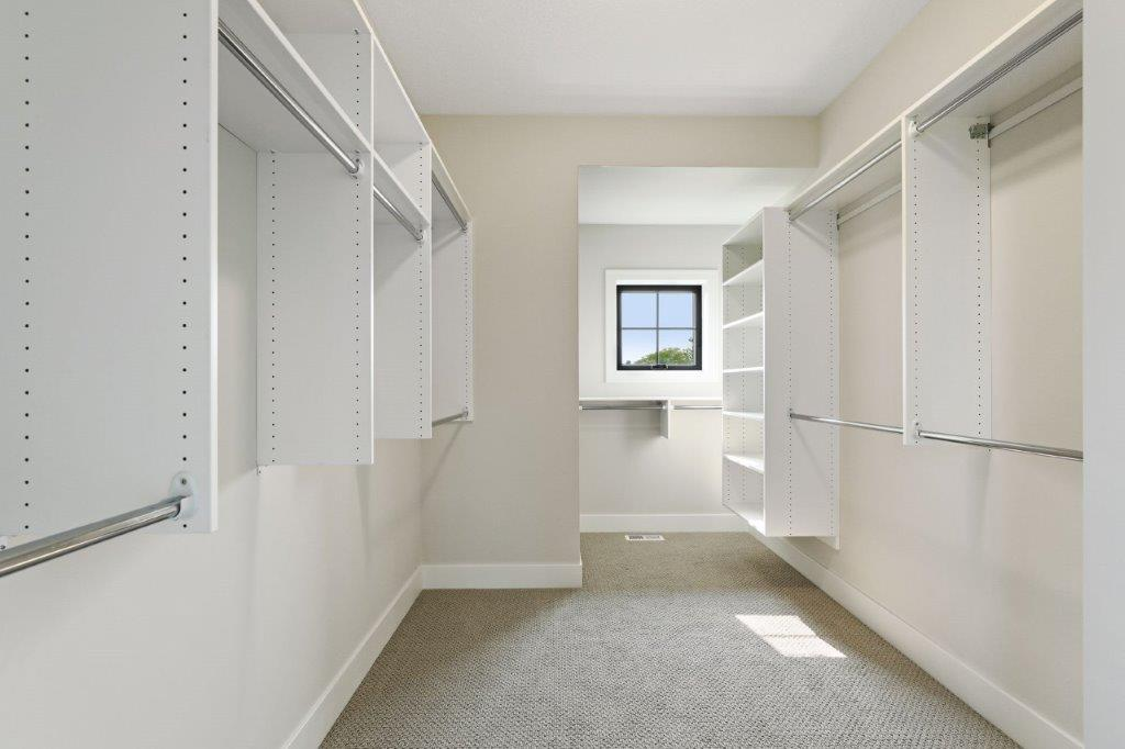 Owners' ensuite walk-in closet with organizers