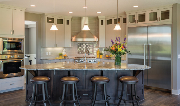 The open kitchen and granite-topped island offer plenty of space for cooking and congregating.