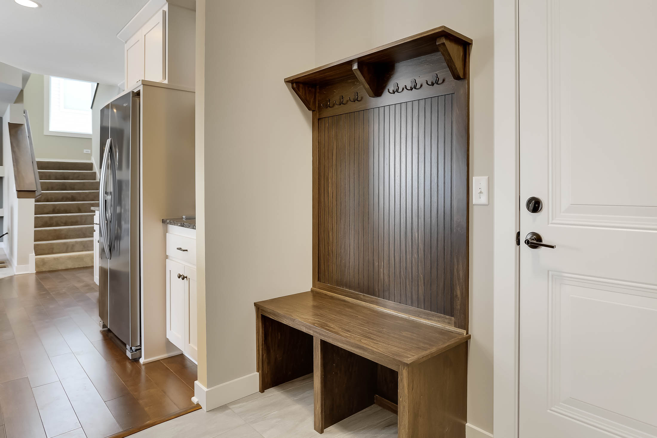 The Mud Room features a large walk-in closet and a Built in Bench with hanging hooks