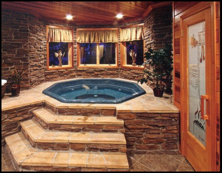 The lower-level hot tub nestles in a stone grotto.