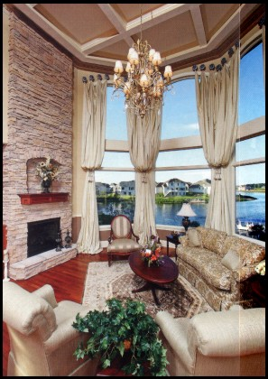 The great room's 18-foot high bay windows fill the space with lake views.